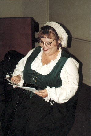 Lady Molli Rose Kekilpenny at a Shire meeting in A.S. XXXIII (1998)