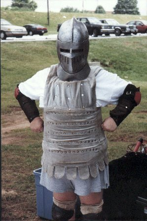 A mysterious houshold member in really old loaner armor at a Pine Log Park fighter practice in the summer of A.S. XXXII (1998)